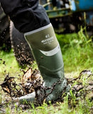 A man wearing the Buckler Safety Wellington boot in olive green