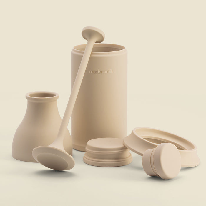 milkpress cream-colored silicone parts in an artistic arrangement