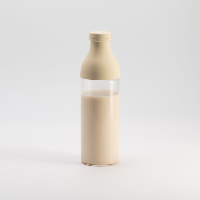 milkpress bottle filled with almond-macadamiamilk