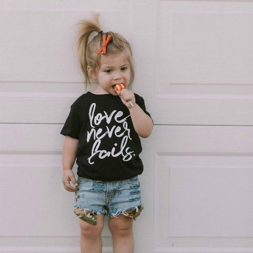 Love Never Fails Children's Tshirt
