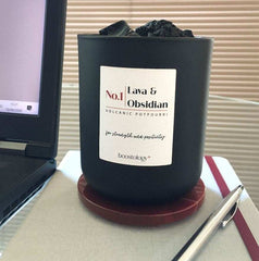 A volcanic diffuser sat next to a laptop