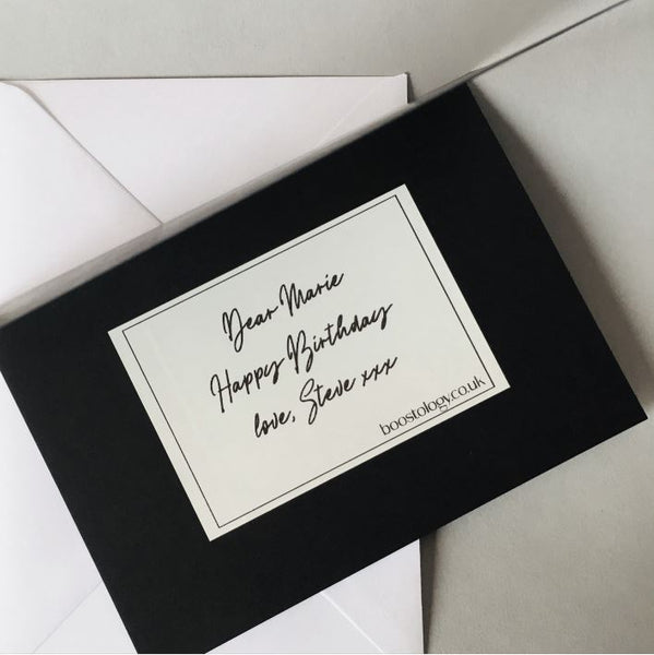 A black gift card with personalised message