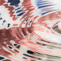 The reflection of a union jack flag in rippling water