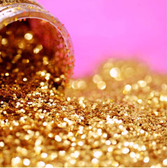 Gold glitter spilling out of a container
