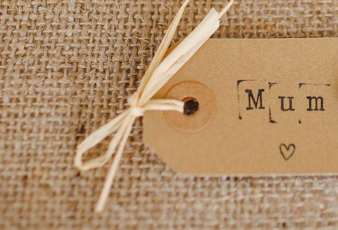 "A gift tag featuring the word ""Mum"" with a heart"