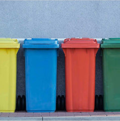 A yellow, blue, red and green recycling bin