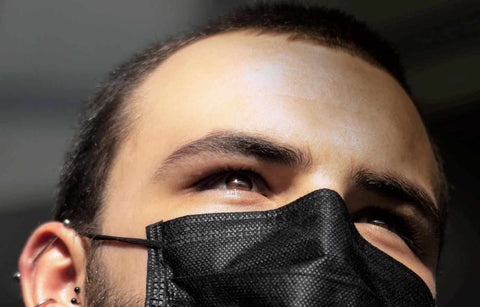 Man wearing a reusable face mask