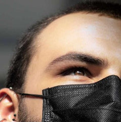 A man wearing a black face mask