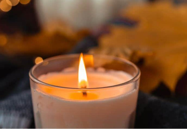 A lit scented candle