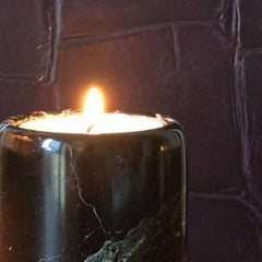 A solid black marble scented candle