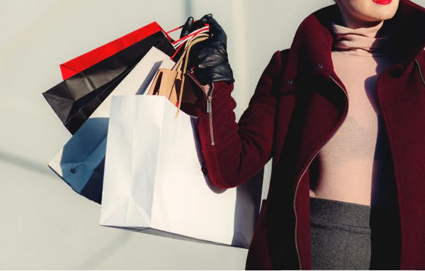 A woman holding lots of shopping bags
