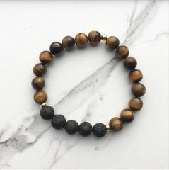Tigers eye diffuser bracelet on a white marble surface