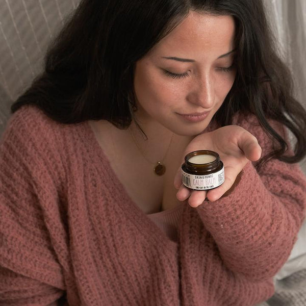 A woman smelling calm balm
