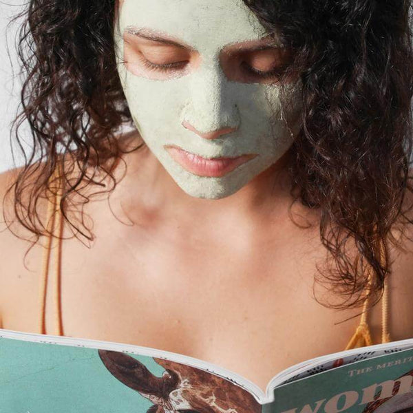 A woman's face after applying the green clay face mask