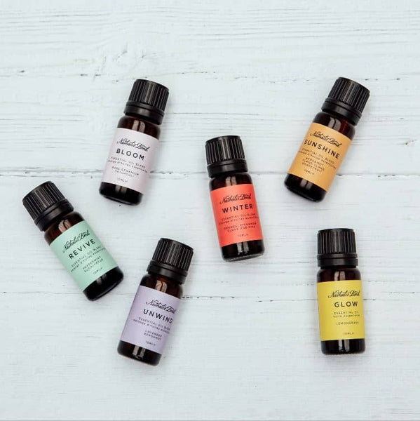 Six essential oil bottles on a wooden background