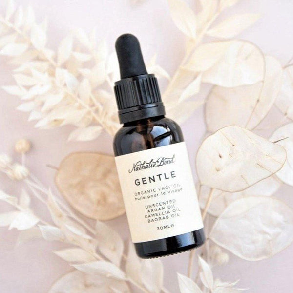 Bottle Of Gentle Face Oil With Dried Flowers