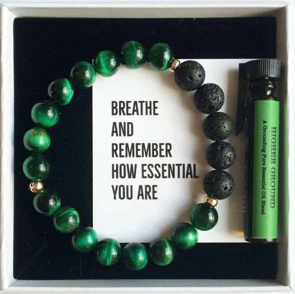 Green tigers eye lava diffuser bracelet with a small bottle of essential oil