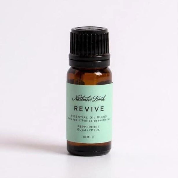 "An amber essential oil bottle with a green label which reads ""REVIVE"""