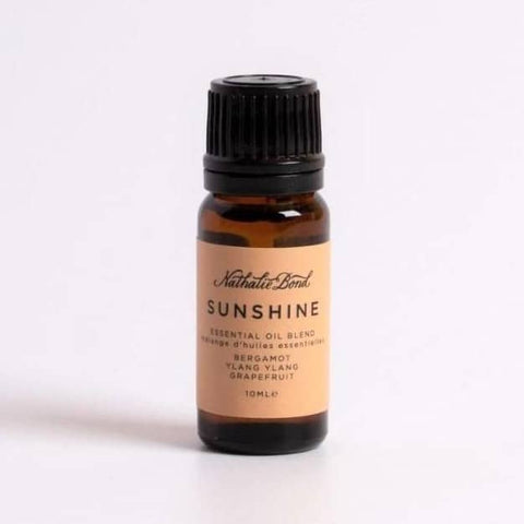 "An amber essential oil bottle with an orange label which reads ""SUNSHINE"""