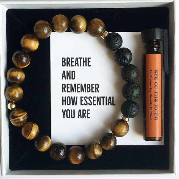 Tigers eye and lava diffuser bracelet with a small bottle of essential oil