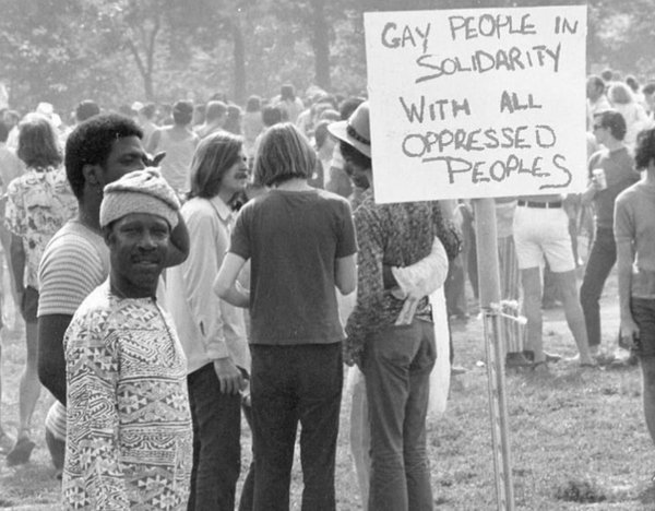 GAY PEOPLE IN SOLIDARITY WITH ALL OPPRESSED PEOPLES vintage LGBTQIA photograph taken Christopher Street Liberation Day, New York City, June 28, 1970