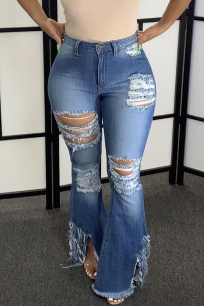 Shredded cut up jeans