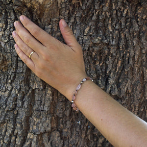 Gemstone bracelet for pregnant women. giving back to charities. hand on tree.