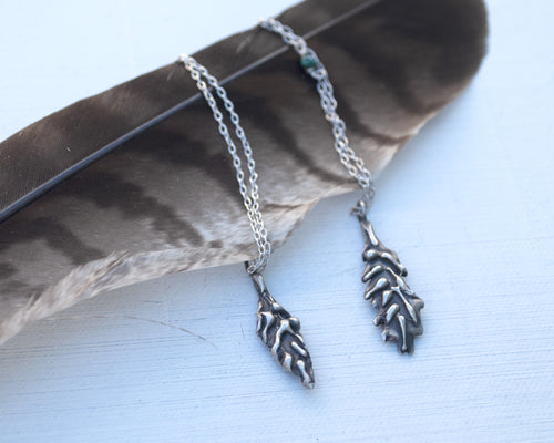Talisman, amulet silver feather necklaces on feather