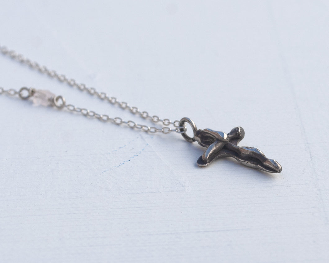 Sterling silver cross pendant on  a chain. Handmade in California.