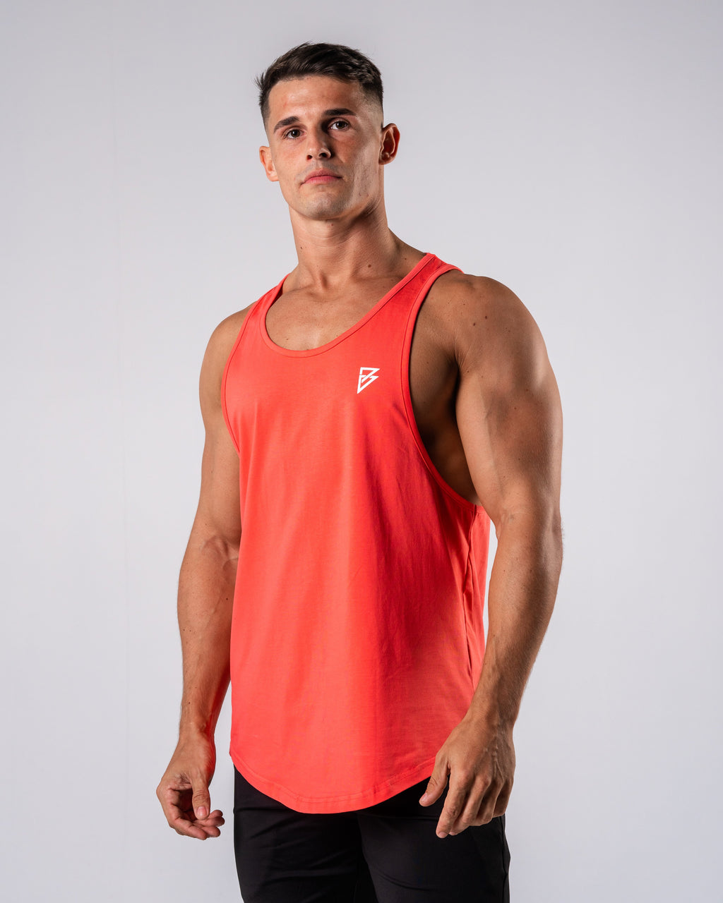 Inspire Cutoff - Coral - FIO Athletics