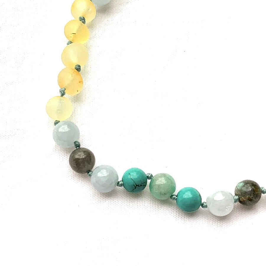 teething necklace with raw amber, turquoise, labradorite, and aquamarine
