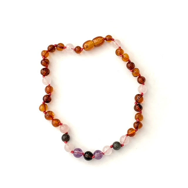 teething necklace with polished cognac amber, rose quartz, labradorite, and amethyst