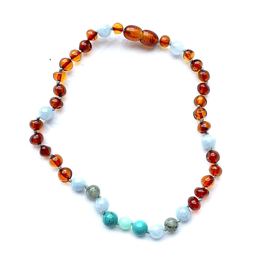 teething necklace with polished cognac amber, turquoise, labradorite, and aquamarine