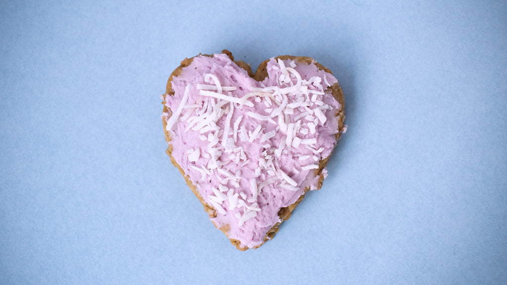 Lavender Valentine Sandwich Cookie with pink frosting and shredded coconut on top