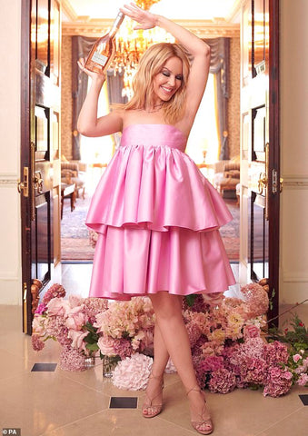 Kylie-minogue-pink-dress-with-bottle