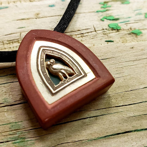 Hand carved pipestone and silver owl Pendant with translucent stone background