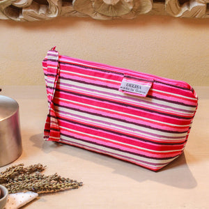 Pink and white striped small sized zipper pouch. Cosmetic bag. Medium sized makeup bag. Toiletry bag. Travel cosmetic case. Medium zipper.