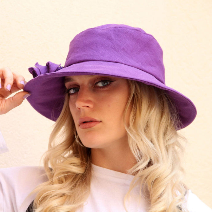 Purple linen wide brim bucket hat.