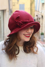 Load image into Gallery viewer, Burgundy cloche hat with asymmetric brim and handmade fabric flower.