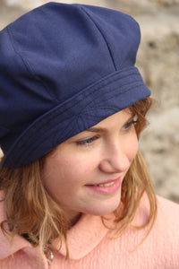 French blue newsberet hat.
