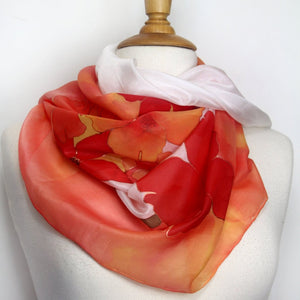 Hand painted silk scarf in bright orange. Vibrant floral silk scarf.