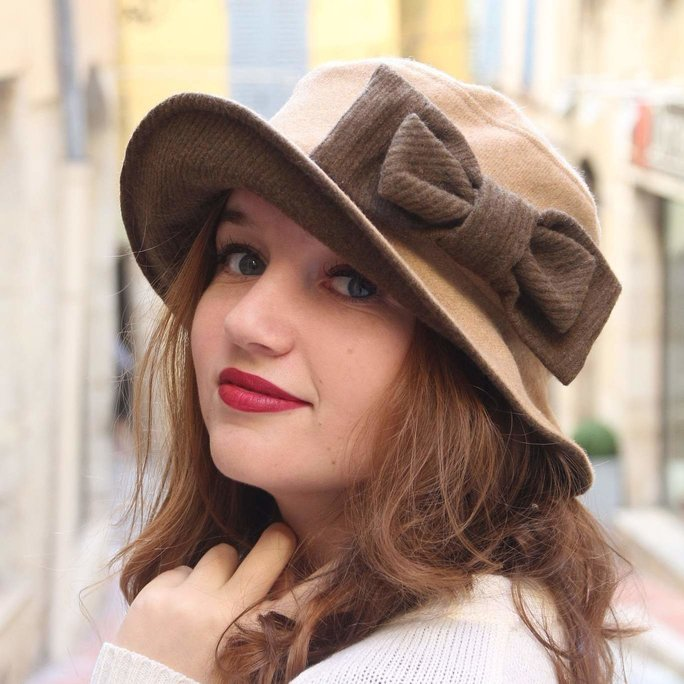 Beige and khaki bucket hat with oversized bow