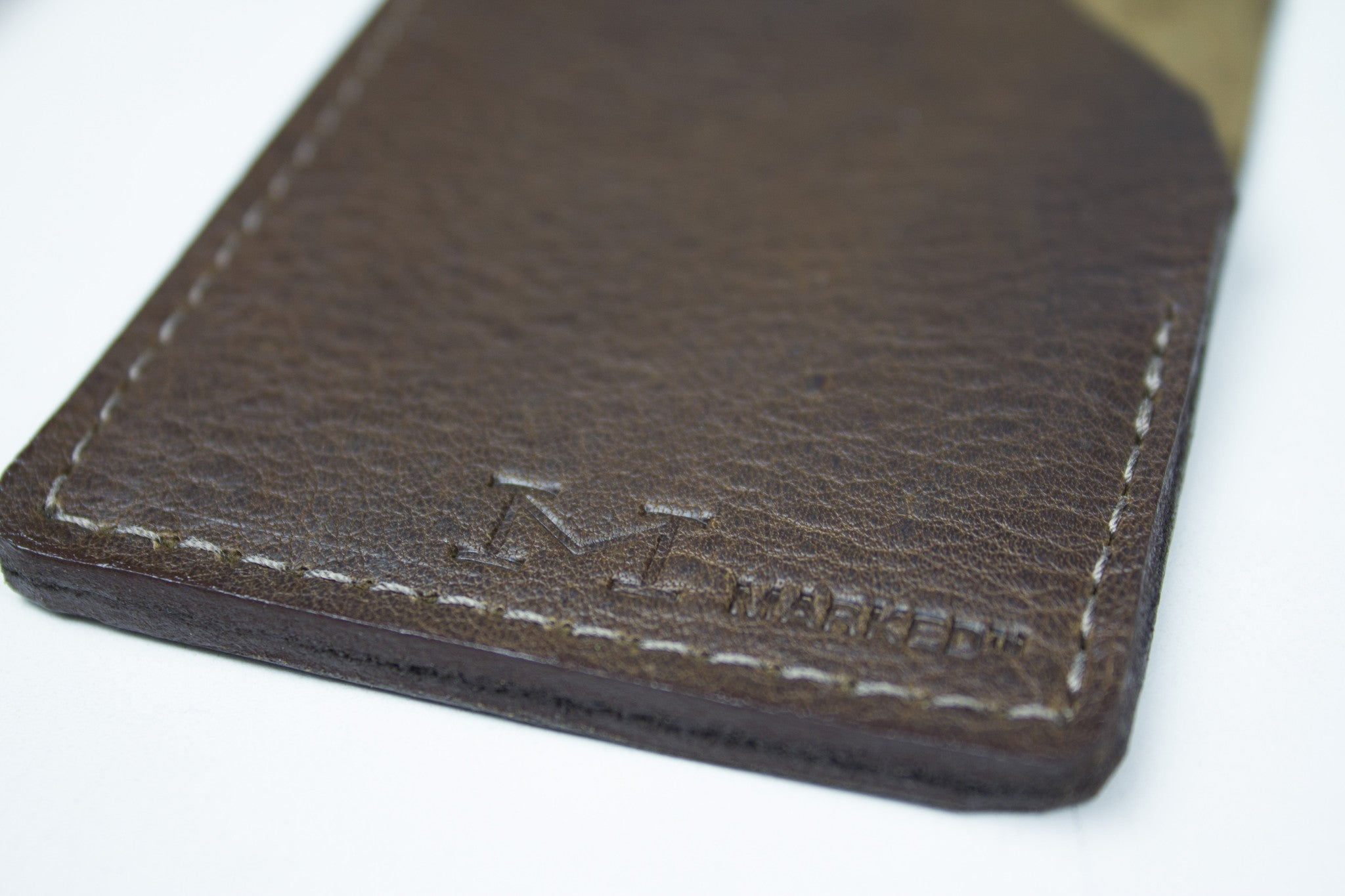 Close up of brown leather card holder