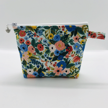 "Load image into Gallery viewer, The pouch is made of 100% quilting cotton from Rifle Paper Co and features a multicolored woodland floral print and a layer of fleece for stability. The cute metal tassel gives an added touch. 6""W x 4.5"" H x 1""D. Machine washable and dryer safe, or air dry."
