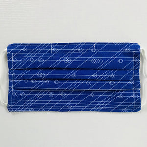 "100% quilting-weight cotton face mask with adjustable elastic ear loops and bendable nose piece. Washable, reusable fabric face mask. Wash in washing machine and dry in dryer after each use. 7"" H x 7.5"" W  This fun cobalt blue fabric with white lines and arrows in from the designer Alison Glass by  Andover Fabrics"
