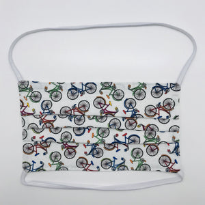 "Masks are made of 100% quilting-weight cotton featuring multi colored bikes on a white background.  This mask has elastic bands and a bendable nose piece. Wash in washing machine and dry in dryer after each use. 7"" H x 7.5"" W"