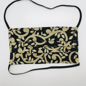 "Masks are made of 2 layers 100% quilting cotton featuring a gold swirls on black print, over the head elastic loops and a bendable aluminum nose. Wash in washing machine and dry in dryer after each use. 7"" H x 7.5"" W."