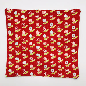 Image of vintage picnic flowers on red fabric print.