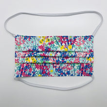 "Load image into Gallery viewer, Masks are made of 2 layers of spring flowers print 100% quilting cotton and have behind the head elastic bands. The masks also have a bendable aluminum nose. Wash in washing machine and dry in dryer after each use. 7"" H x 7.5"" W"