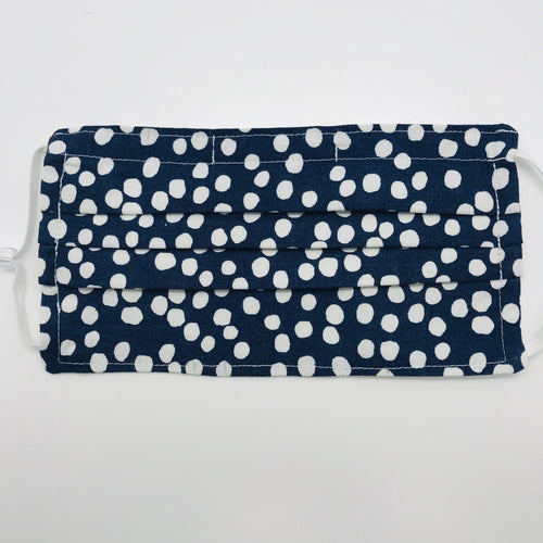 "Masks are made of 2 layers of 100% quilting-weight cotton featuring a white dot on blue print. The mask has elastic adjustable ear loops and a bendable aluminum nose piece which helps to make a better seal over the wearers face. Machine wash and dry after each use. 7"" H x 7.5"" W"
